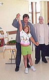 Sasha dancing with Papa and Greg